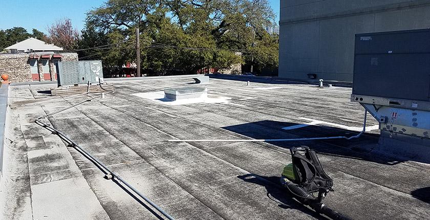 Aged modified bitumen roof repair.